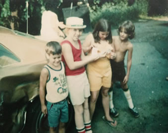 Next to the 1977 Malibu - Guess which one is me.