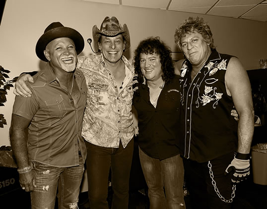 l to r: Derek St. Holmes, Ted Nugent, Greg Smith, Mick Brown (photo: James & Marilyn Brown)