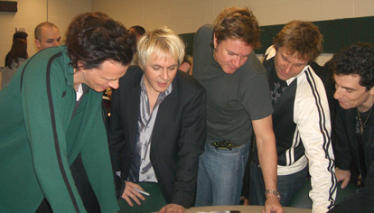 The entire band captivated by Golub's poster in 2005!